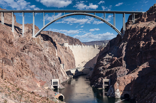Hoover Dam bypass bridge desert canyon view with cloudy sky.