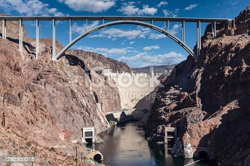 istock Hoover Dam Bypass Bridge Canyon View with Cloudy Sky 1285939318