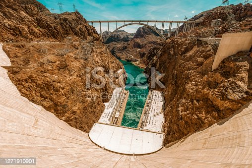 The Hoover Dam in the Black Canyon of the Colorado River on the border between Nevada and Arizona, USA, seen a hot summer day.