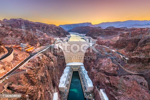Hooover Dam on the Colorado River straddling Nevada and Arizona at dawn.