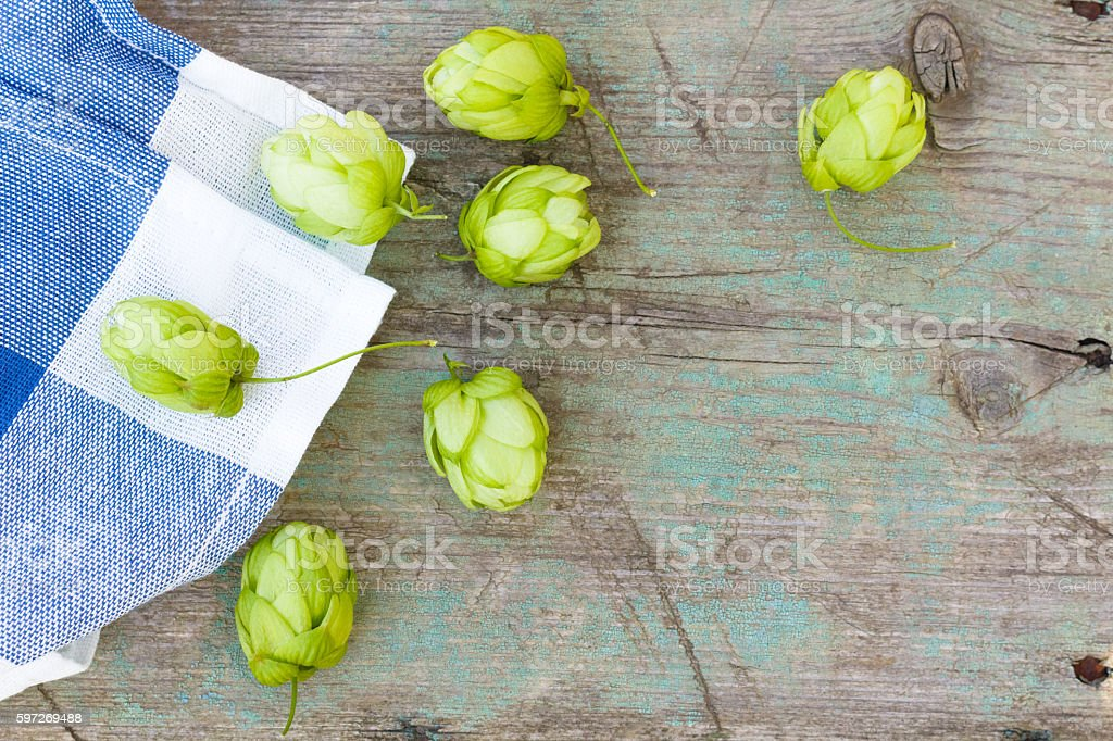 hop cones on the old wooden background, top view royalty-free stock photo