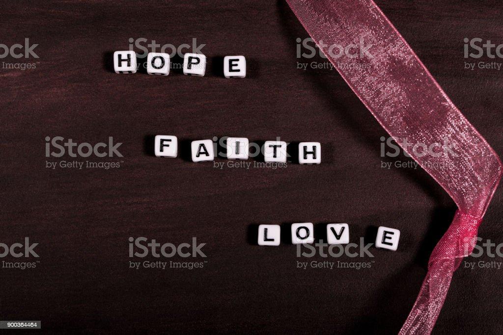 Hope Faith and Love words stock photo