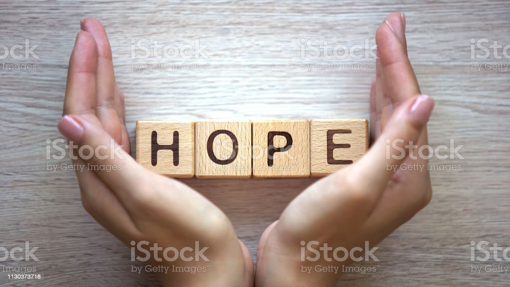 Hope word made by female hands, family creation, expectancy of baby, happiness - Zbiór zdjęć royalty-free (Antycypacja)