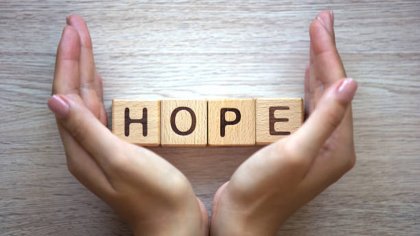 Hope word made by female hands, family creation, expectancy of baby, happiness Hope word made by female hands, family creation, expectancy of baby, happiness religious symbol stock pictures, royalty-free photos & images