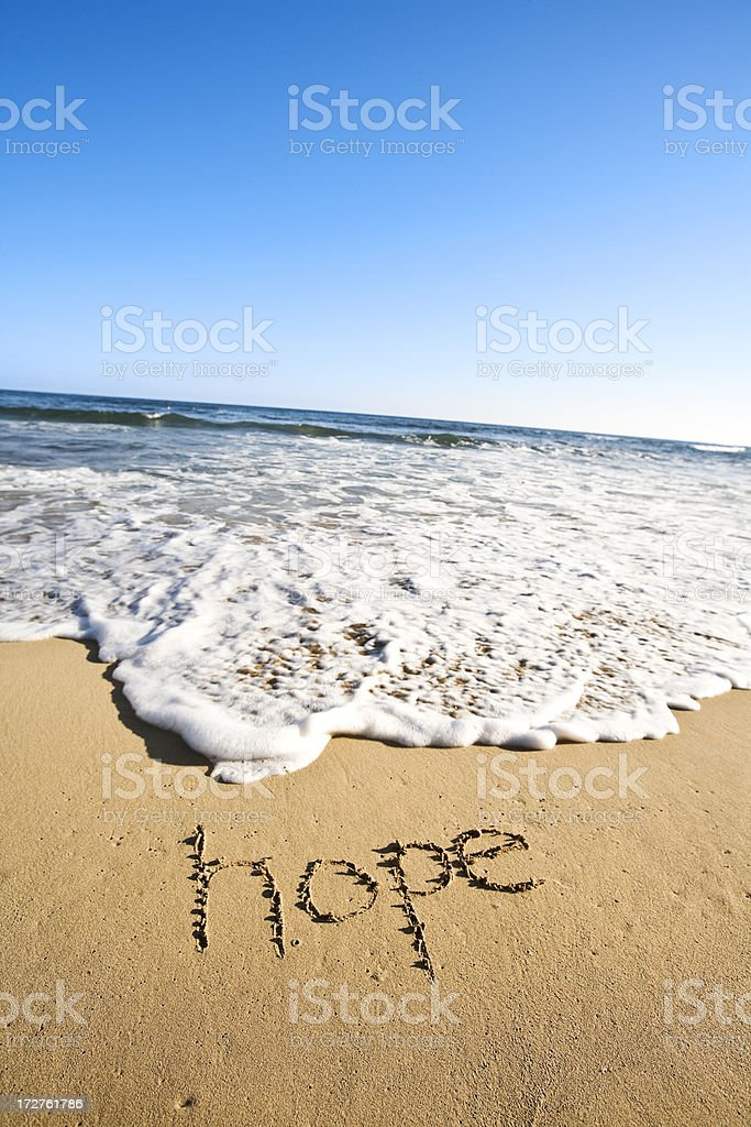 hope written in the sand stock photo
