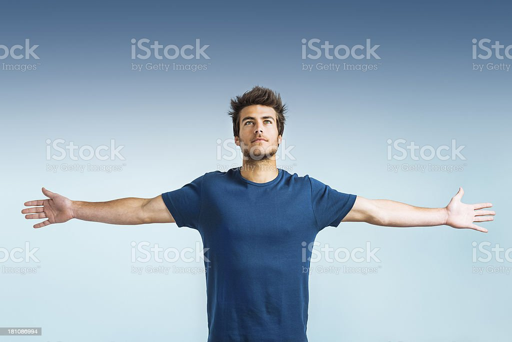 Hope: young man with arms outstretched royalty-free stock photo