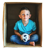 Child Series Involving Cardboard Box and Shelter In Place Activities During Virus Crisis Hopeful Boy (Shot with Canon 5DS 50.6mp photos professionally retouched - Lightroom / Photoshop - downsampled as needed for clarity and select focus used for dramatic effect)