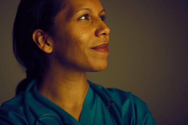 hopeful female doctor stock photo