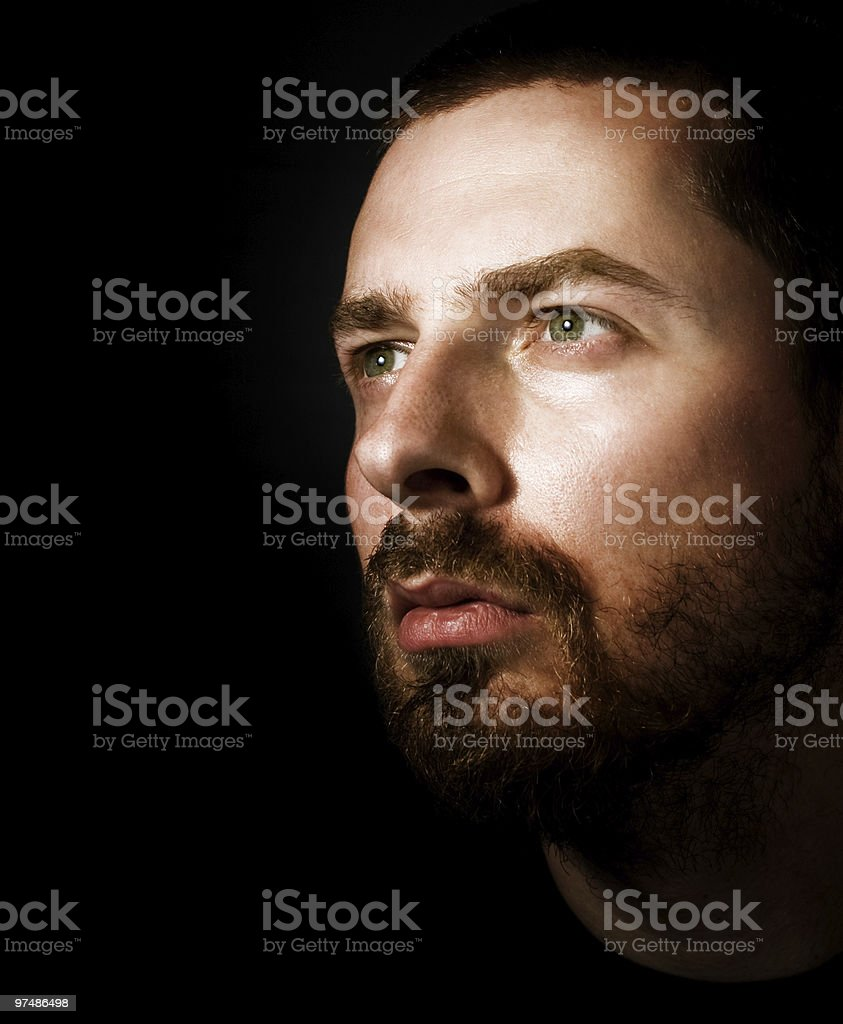 Hopeful man looking into the light royalty-free stock photo