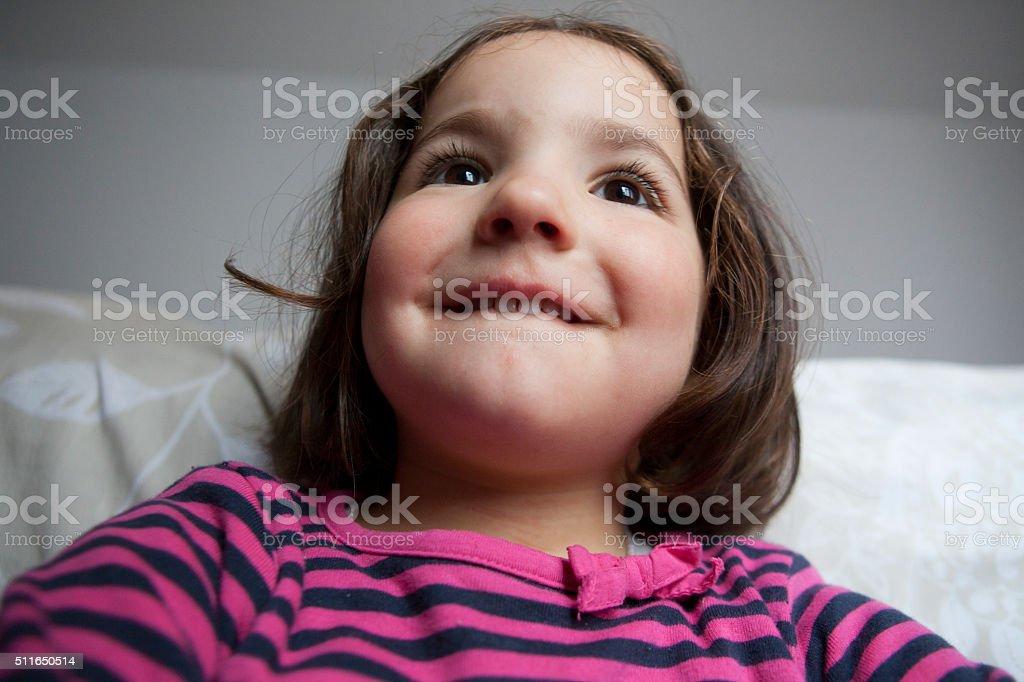 Hopeful three years old  little girl stock photo
