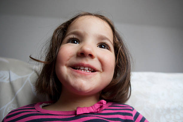 hopeful three years old  little girl - delude stock pictures, royalty-free photos & images