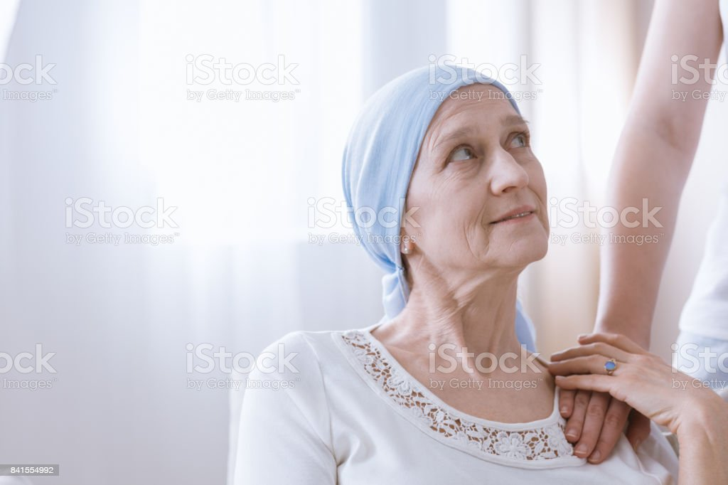 Hopeful woman after cancer treatment stock photo