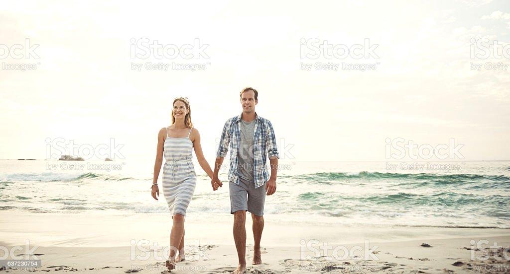 Hopeless romantics at the beach stock photo