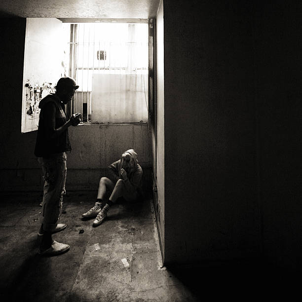 hopelessness junkie couple. drug dealer stock pictures, royalty-free photos & images