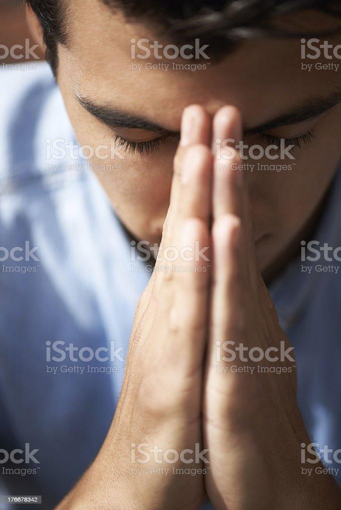 Hoping and praying royalty-free stock photo