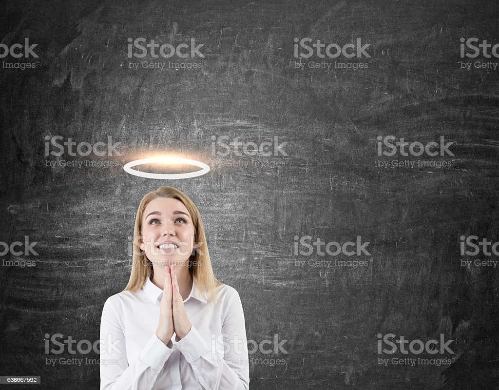 Hoping woman with a halo stock photo