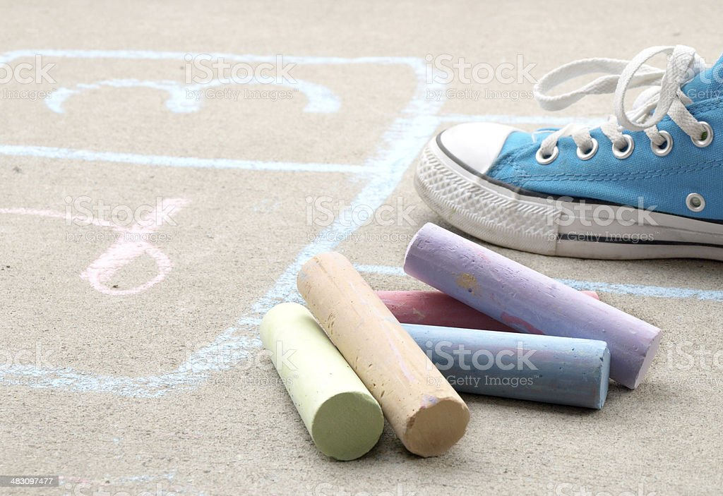 Hopscotch and Sidewalk Chalk on Cement stock photo