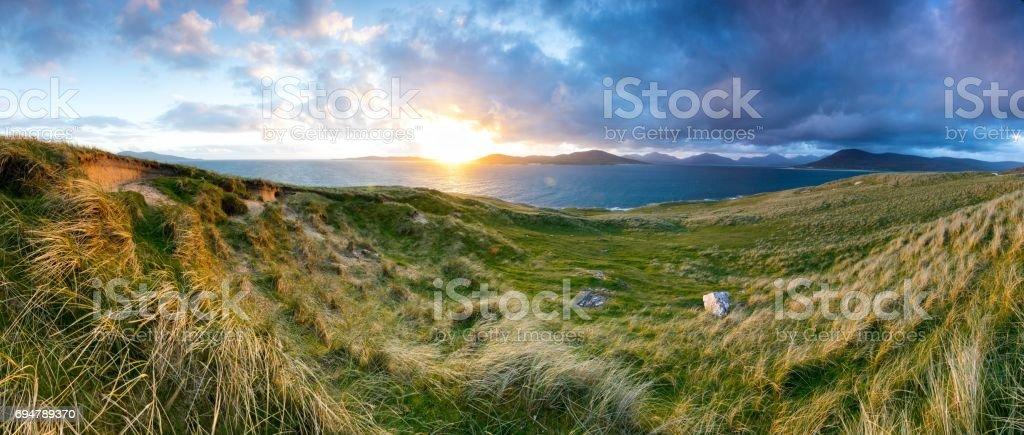 Horgabost panorama across to Taransay and Huisinis hills beyond at sunset stock photo