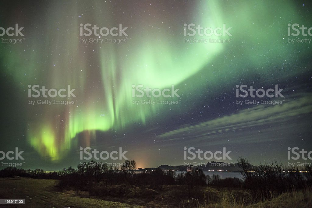 horiziontal composition of aurora borealis over the sea stock photo