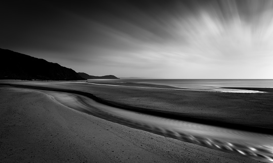 Horizon Highlights and sunrays, Pentewan Sands, Cornwall
