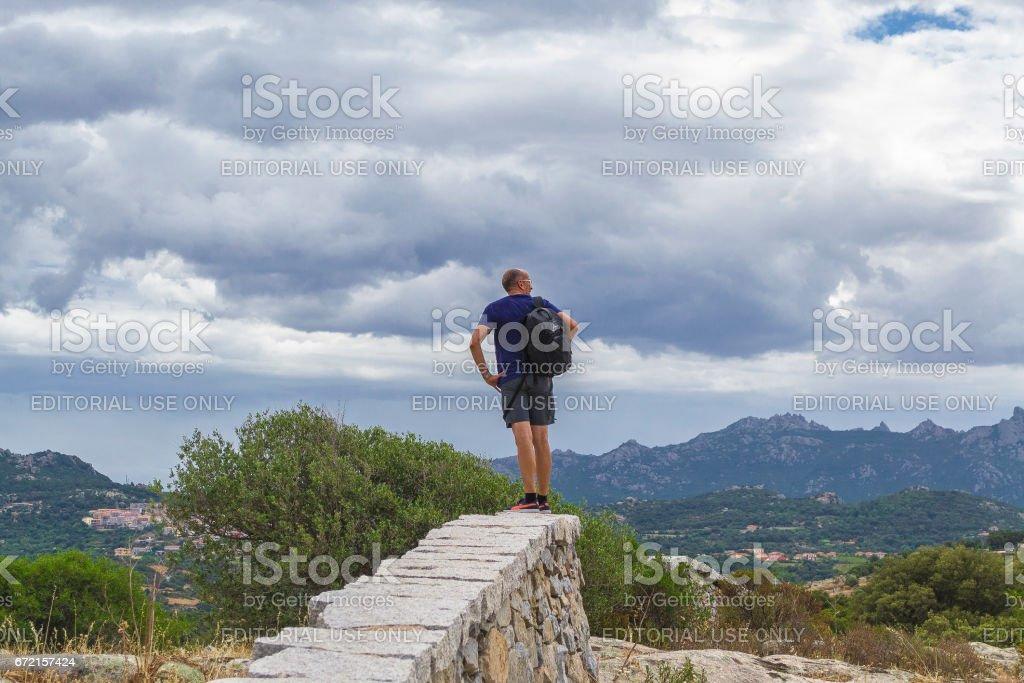 Horizon in northern Sardinia with a tourist (Italy). stock photo