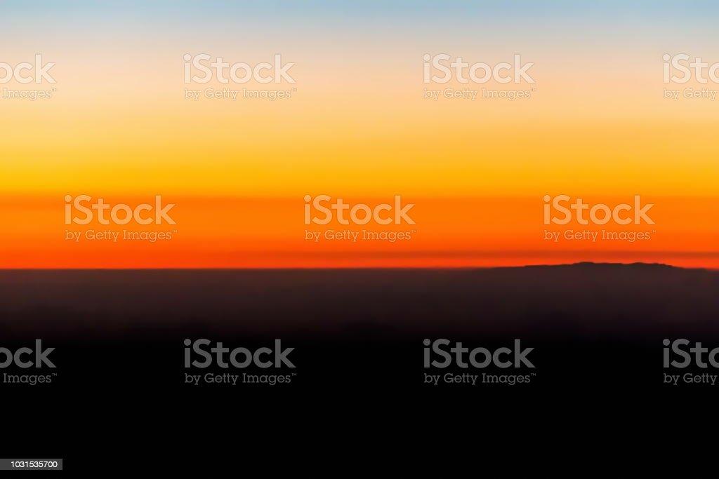 Horizon line of orange sky and clouds with beautiful golden orange...