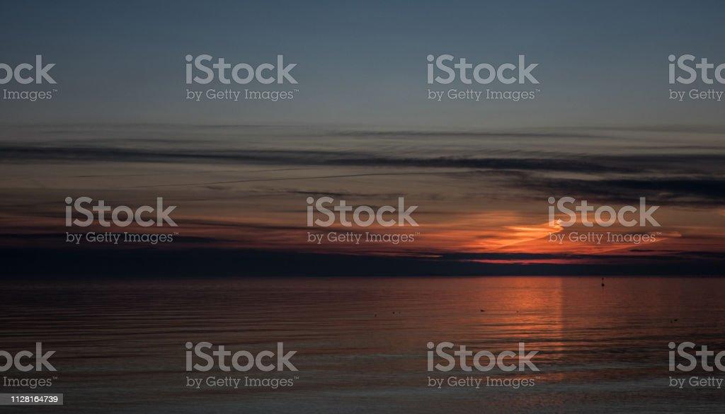 Horizon over Water at Sunset on The Sistiana Coast, Italy