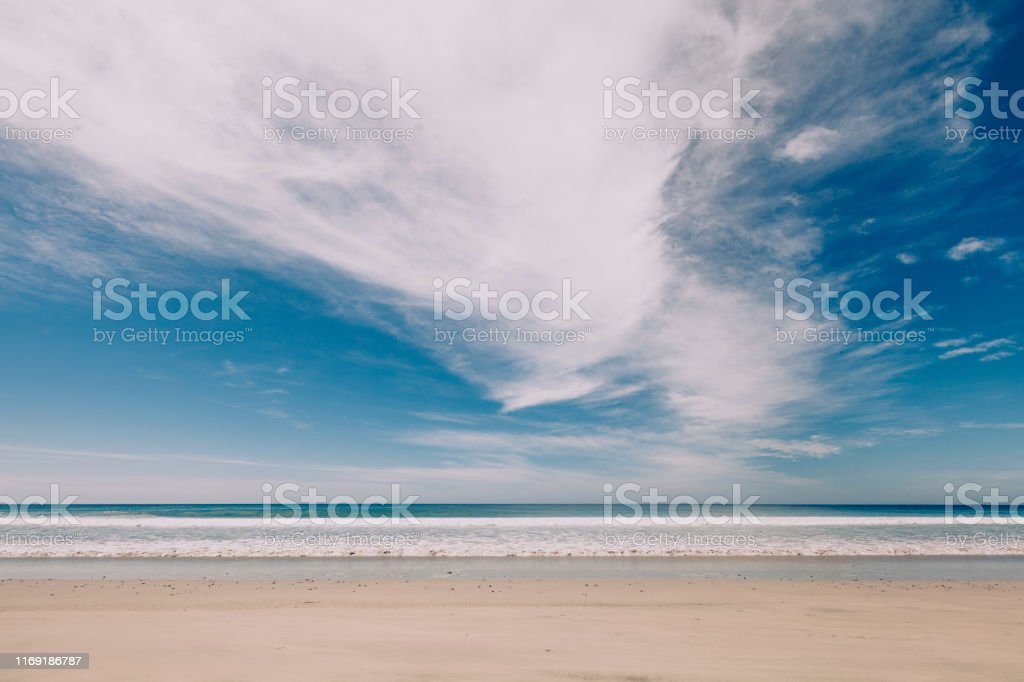 horizon over water, beach and seascape with dramatic cloudscape,...