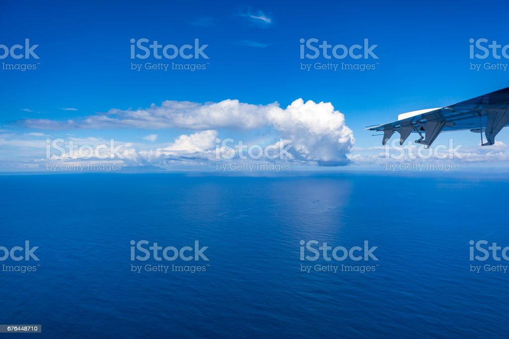 beautiful cloudscape with rainbow over the indian ocean, seychelles,...