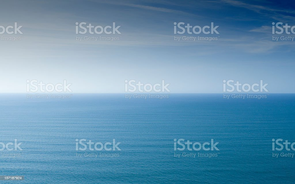 Horizon showing a calm sea and clear sky stock photo
