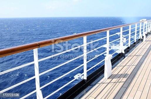 Watching the horizon from a cruise ship deck