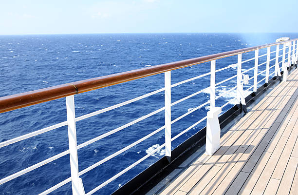 Horizon view from empty cruise ship deck on a sunny day Watching the horizon from a cruise ship deck railing stock pictures, royalty-free photos & images