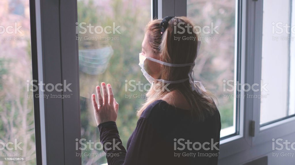 horizontal background woman in isolation at home for virus outbreak or hypochondria horizontal background woman in isolation at home for virus outbreak or hypochondria . Adult Stock Photo