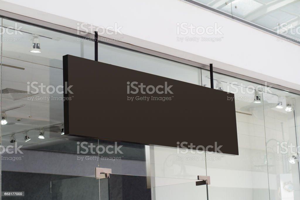 horizontal black signage on shop front stock photo