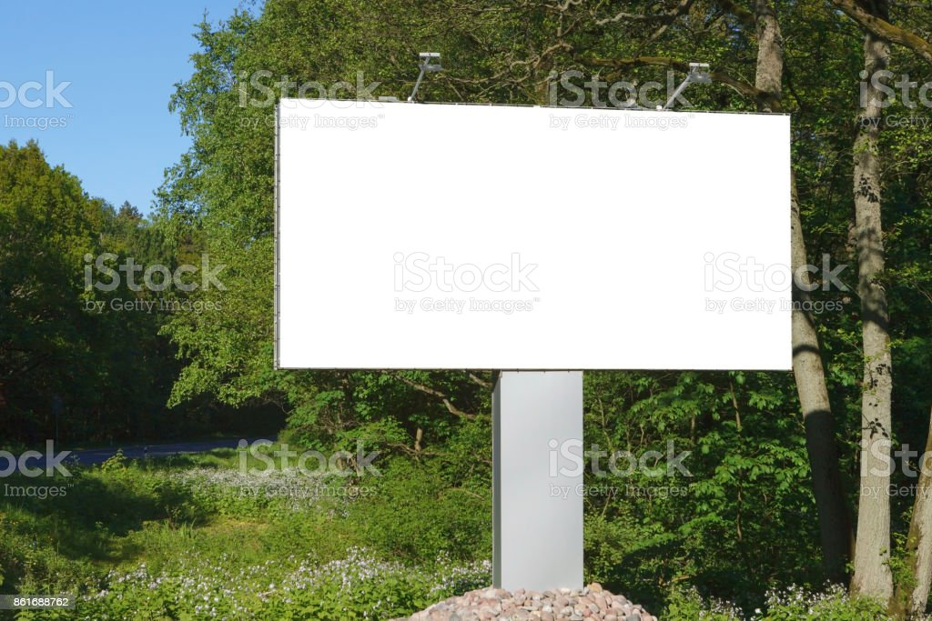 horizontal blank billboard on the background of green trees, mock up stock photo