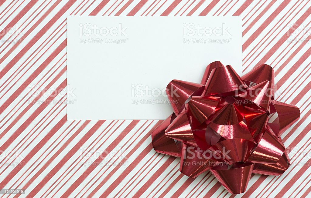 Horizontal blank card on red striped paper with bow royalty-free stock photo