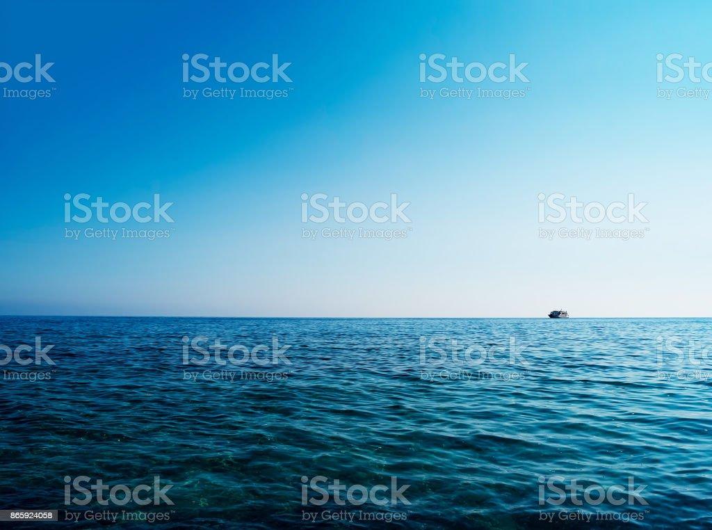 Horizontal blue ocean ship on horizon background stock photo