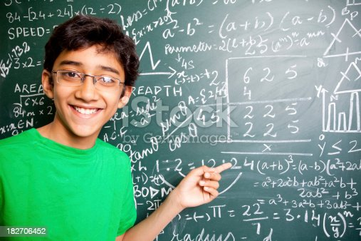 istock Horizontal Cheerful Indian Teenager Boy Student with Mathematics Problems 182706452