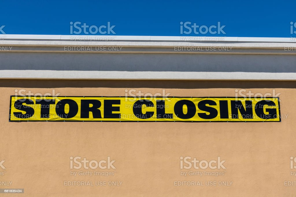 Horizontal Close Up Shot Of Store Closing Sign On A Retail Mall Business I stock photo