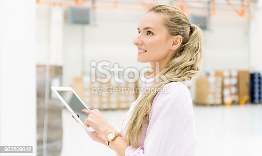 544976664 istock photo Woman at distribution warehouse & delivery 963509648