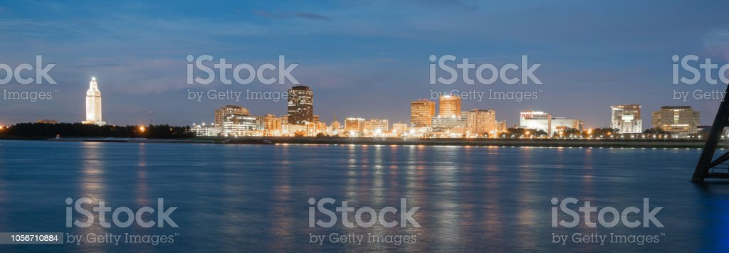 Horizontal composition covering the Mississippi River waterfront and the State Capitol of Louisiana at Baton Rouge stock photo