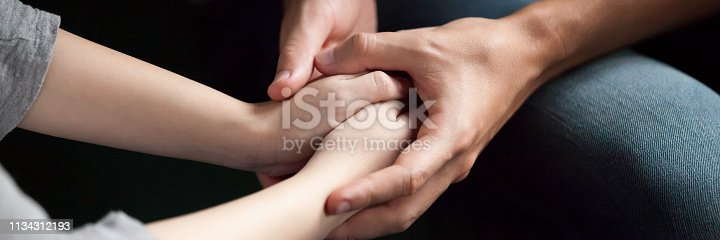 Close up man woman holds hands couple reconcile make peace after quarrel show care love empathy in relation give psychological support concept banner for website header design with copy space for text