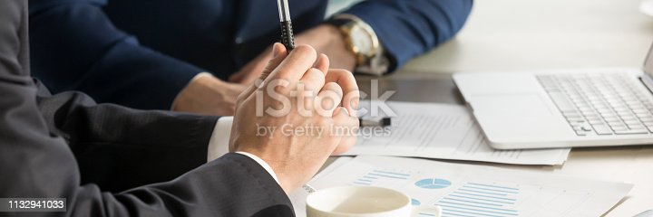 istock Horizontal cropped image businessmen brainstorming using charts shown at papers 1132941033
