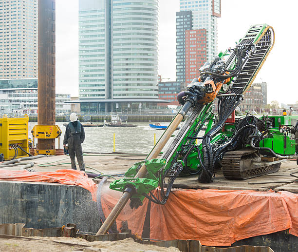 horizontal directional drilling (hdd)  machinery working in rotterdam. - drill stock photos and pictures