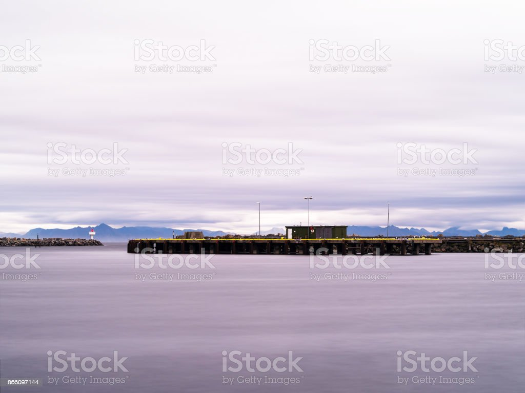 Horizontal dramatic Norway northern pier quay cloudscape backgro stock photo
