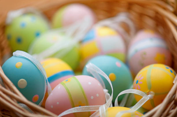 Horizontal Easter eggs in basket stock photo
