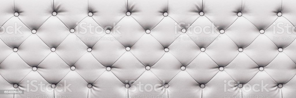 horizontal elegant white leather texture with buttons for background and design stock photo