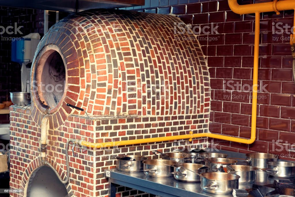Horizontal gas heated tandoor oven in restaurant kitchen, toned royalty-free stock photo