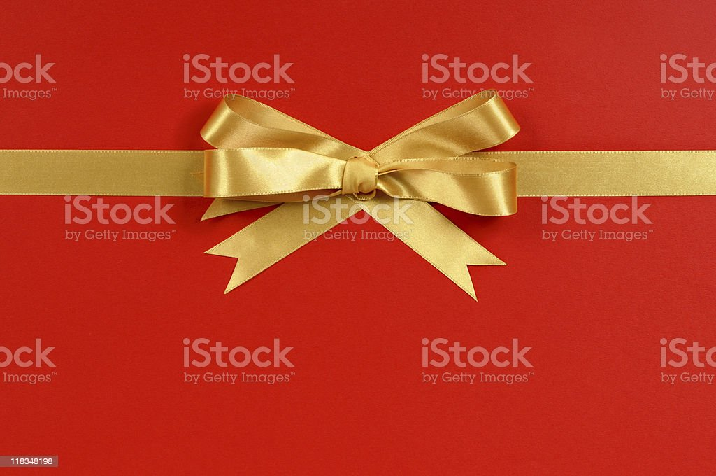 Horizontal gold ribbon on red background royalty-free stock photo
