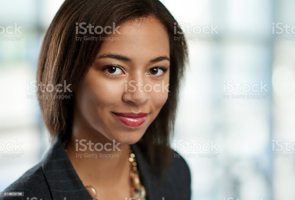 Horizontal headshot of an attractive african american business woman shot stock photo